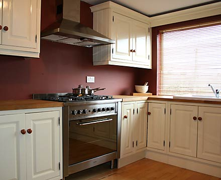 Home and insurance red painted kitchens for Dark red kitchen cabinets